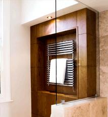 WC with concealed cistern and cherry and stainless steel towel rack.