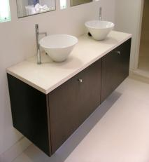 Double vanity unit with top mounted wash basins.