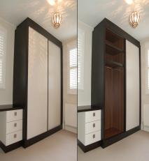 Sliding door wardrobe in dark stained oak and colour lacquer.