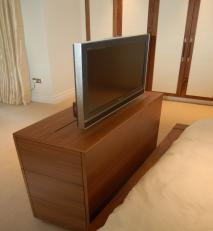 Electrically driven, with remote control plasma television unit at bed end.