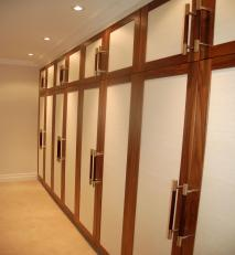 Solid walnut wardrobe with silk paper panelled doors.