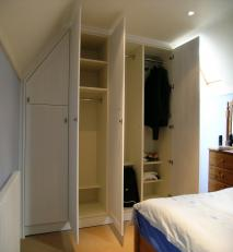 Built-in wardrobe with a combination of hanging space and adjustable shelving.