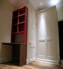 Free standing wardrobe with panelled doors and dressing table.