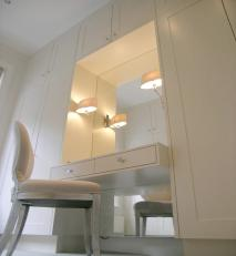White lacquered wardrobe with mirrored dressing table.