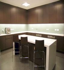 Office kitchen. laminate, solid surface tops and glass splashbacks.