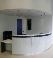 Reception desk in laminates and solid surfacing.