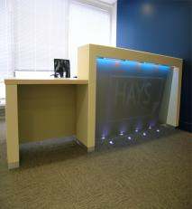 Nextel® coated reception desk with company logo.