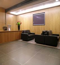 Cherry panelled reception area with plasma screen.