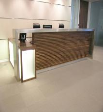 Walnut with stainless steel reception desk.