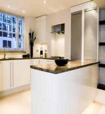 Fitted kitchen in satin white with venetian granite work surfaces.