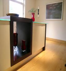 Island unit in dark oak, glass and lacquered mdf.