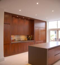 Kitchen in walnut and engineered stone.