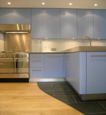 Pale blue lacquered units with stainless steel tops and appliances.