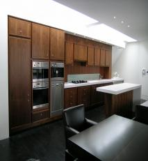 American black walnut with white Corian®work surfaces.