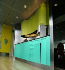 Metallic coloured laminates used in office kitchenette.