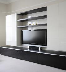 Dark stained oak and high gloss lacquered living room unit.