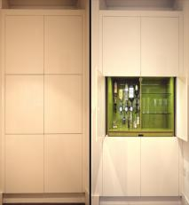 High gloss lacquered home-bar unit with pocket doors. Shown here closed and open.