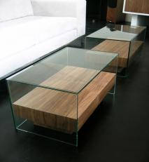 Coffee tables in walnut and glass.