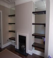 Bracketless shelves with a mirrored back wall.