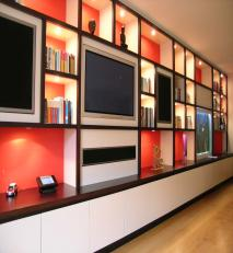 Extensive wall display unit incorporating plasma television and aquarium.