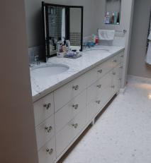 Vanity unit in Cararra marble with hand-painted fronts.