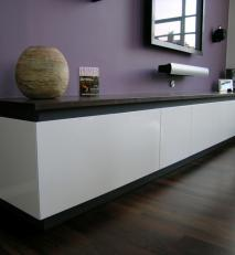 Wall-hung AV unit in wenge and white lacquer.