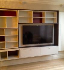 Media unit in dark oak and coloured lacquers.
