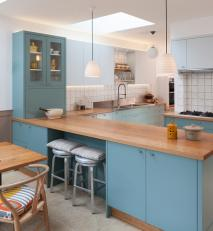 contemporary kitchen with a nod to to the traditional. Hand painted with oiled oak and stainless worktops